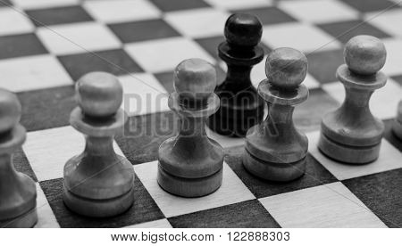 The Chessboard black and white pawns atack, monochrome photo