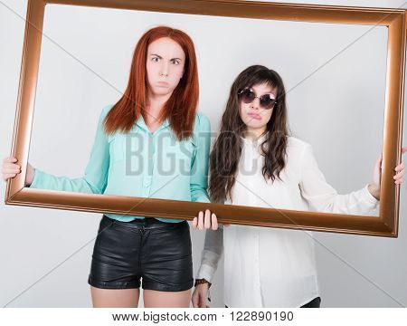 two girls girlfriend got into the frame of the picture, optimistic lady having solution and bored, annoyed clueless sad woman. Human emotion face expression feeling, life approach.