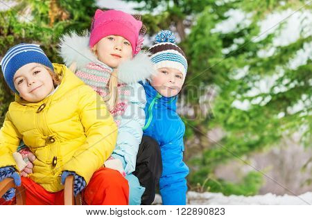 Close portrait of kids in winter clothes outside on snow winter day