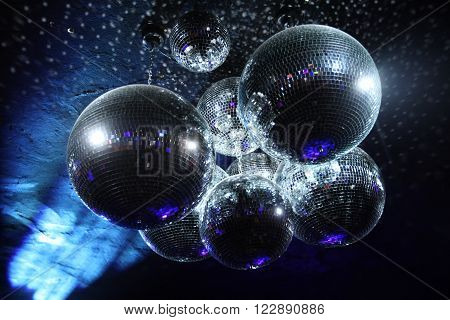 Shiny disco balls on a dark background