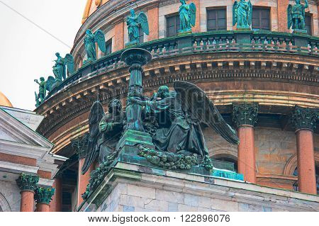 Saint Petersburg, Russia - Feb 26, 2016: Angels statues on fasade of  Saint Isaac's Cathedral. Detail.