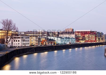 View of waterfront buildings in Frankfurt Main Osthafen at dusk. Hesse Germany