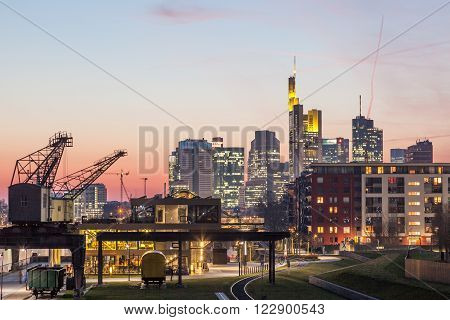 View over the city of Frankfurt Main with old cranes in the foreground. Frankfurt Germany