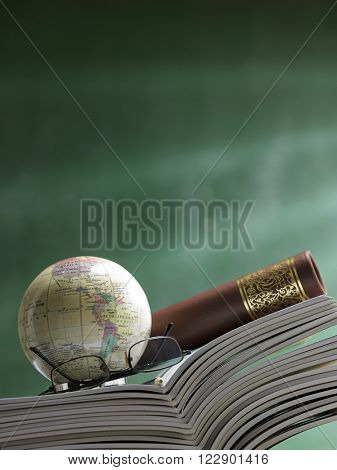 stack of the workbook,desk globe and certificate