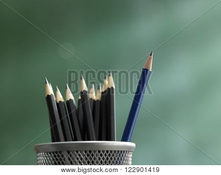 pencil in front of blackboard ,concept  stand out from the crowd