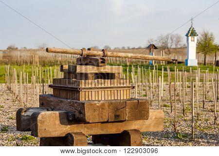 wine press and wayside with vineyard near Velke Bilovice, Czech Republic