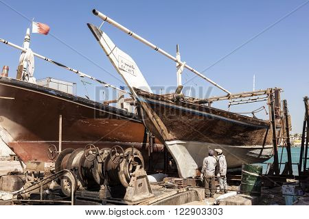 MANAMA, BAHRAIN - NOV 14: Dhow boat in a dockyard of Bahrain. November 14, 2015 in Manama, Kingdom of Bahrain, Middle East