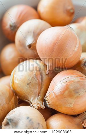 Close - up Pile of small gold onion