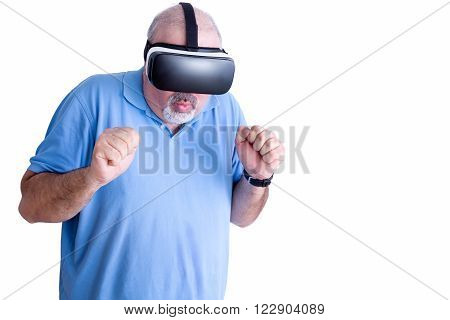 Single middle aged bearded and balding man in blue shirt reacting to action in virtual headset over white background