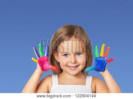 Kid painting hand.