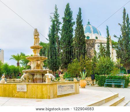 BETHLEHEM PALESTINE - FEBRUARY 18 2016: The small fountain with sculptures of animals and the shepherd located next to the Shepherds Chapel on February 18 in Bethlehem.