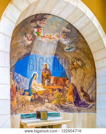 BETHLEHEM PALESTINE - FEBRUARY 18 2016: The fresco depicting a biblical scene of adoration of the shepherds on February 18 in Bethlehem.