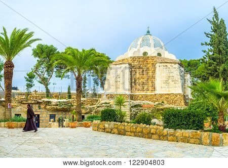 BETHLEHEM PALESTINE - FEBRUARY 18 2016: The franciscan monc walk in the courtyard of the Cave Church after the mass on February 18 in Bethlehem.