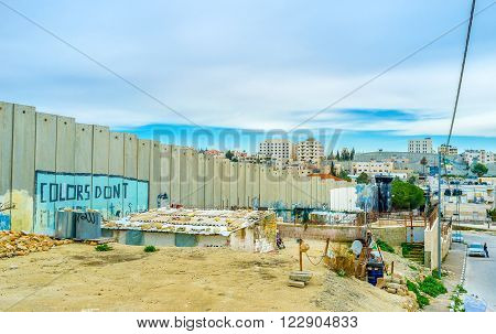 BETHLEHEM PALESTINE - FEBRUARY 18 2016: The living building next to the separation wall is a part of the refugee camp on February 18 in Bethlehem.