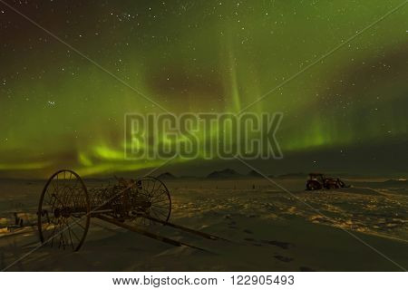 Aurora Borealis In Iceland Skies. Auroras Are Produced When The Magnetosphere Is Disturbed By The So