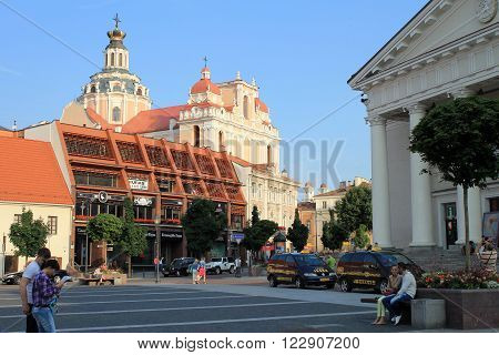 VILNIUS, LITHUANIA - JULY 18, 2015 : Tourists on The Town Hall Square and St. Casimir Church in Vilnius Old Town, Vilnius, Lithuania.