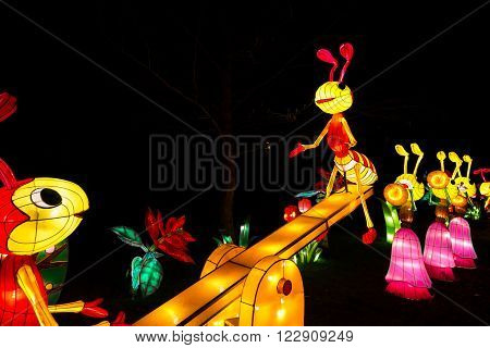 London United Kingdom - February 07 2016: Magical Lantern Festival at Chiswick House And Gardens. Installation of ants playing at a teetering board