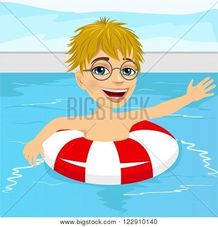Portrait of cute little boy swimming in pool with inflatable ring