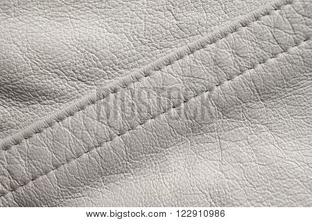 White leather close up, diagonal stitching detail