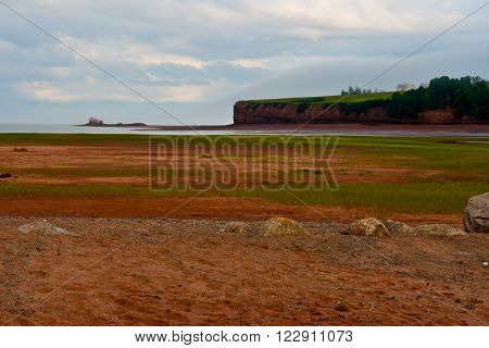 Low tide of the Minas Basin - Delhaven Nova Scotia, Paddys Island ( North Medford) in the distance.