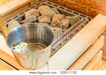 water with floating flowers and stones in the sauna