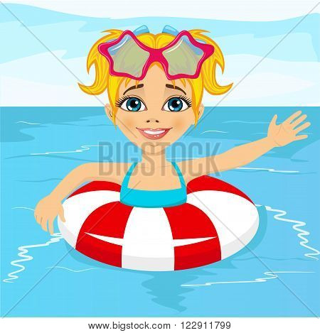 Portrait of cute little girl swimming in pool with inflatable ring