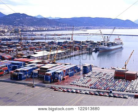 SALERNO, ITALY - SEPTEMBER 23, 1996 - View across the containerbase and docks towards the coastline and mountains Salerno Campania Italy Europe, September 23, 1996.