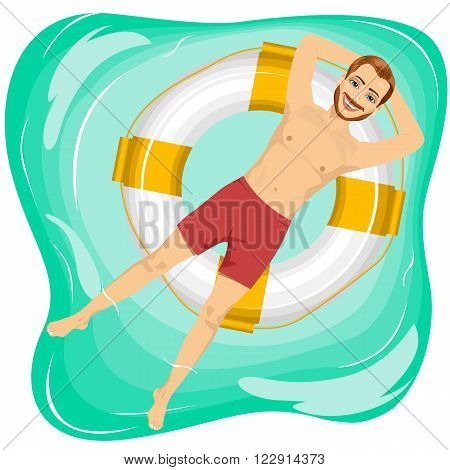 top view of young handsome man floating on an inflatable circle in the pool