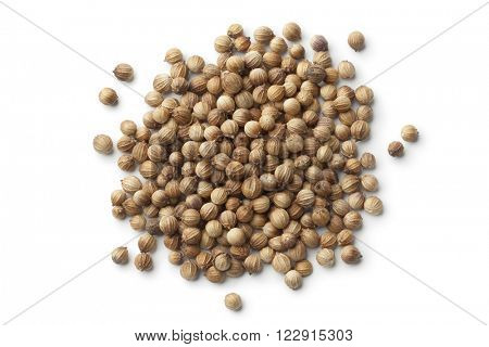 Dried coriander seeds on white background
