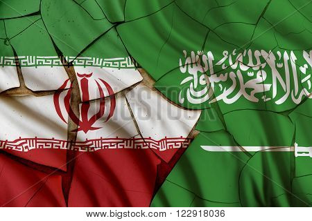Flags of Iran and Saudi Arabia on a cracked paint wall. A symbol of conflict between 2 nations Tehran and Riyadh which have been strained over different geo-political issues i.e oil export policyetc