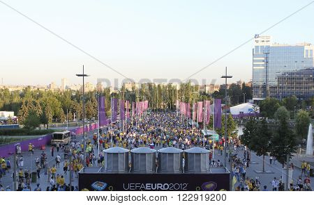DONETSK UKRAINE - JUNE 19 2012: Fans go to the EURO 2012 match in Donetsk at Donbass Arena
