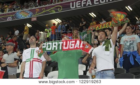 DONETSK, UKRAINE - JUNE 27, 2012: Unidentified Portugal soccer fans before UEFA EURO 2012 match in Donetsk on Donbass Arena