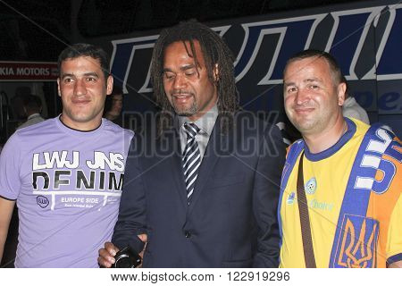 DONETSK UKRAINE - JUNE 20 2012: Christian Karembeu after the match of Euro 2012 in Donetsk with fans