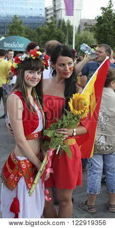 DONETSK UKRAINE - JUNE 27 2012: Unidentified Spanish and Ukrainian girl soccer fans before UEFA EURO 2012 match in Donetsk near Donbass Arena