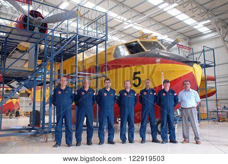 ANKARA-TURKEY-MAY 6 : Firefighter aircraft Canadair CL-215 and maintenance crew at the Turkish Air Association's Etimesgut Airport's hangar. May 6, 2012-Ankara/Turkey