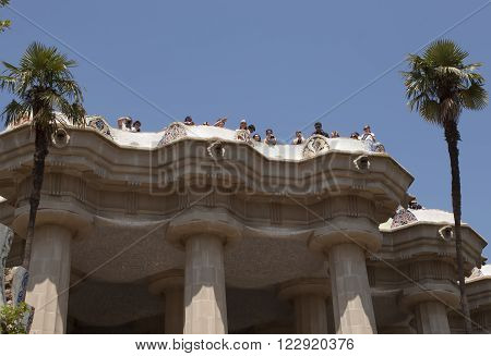 BARCELONA, SPAIN - JULY 12, 2013: Architectural masterpieces of Antoni Gaudi in Guell park attract many tourists