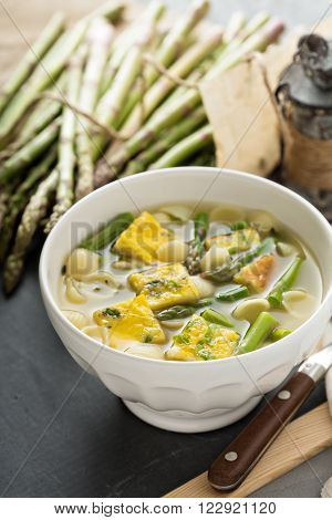 Homemade asparagus and frittata soup with small pasta