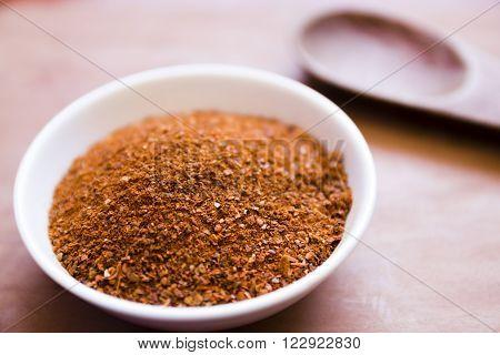 El merkén o merquén (del mapudungun: medkeñ) es un aliño preparado con ají seco ahumado y otros ingredientes. Es un condimento picante con algo de sabor ahumado y tiene aspecto de polvo rojo con pequeñas escamas de diferentes tonalidades. Es tradicional e