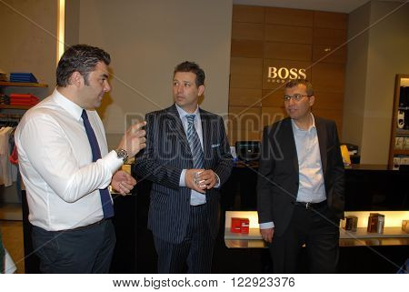 ANKARA/TURKEY-MAY 31: Justice and Development Party (AKP) Cankaya Branch President Mr. Suleyman Yilmaz (R) at the Hugo Boss store of Panora AVM before local elections of Turkey. May 31, 2013-Ankara/Turkey