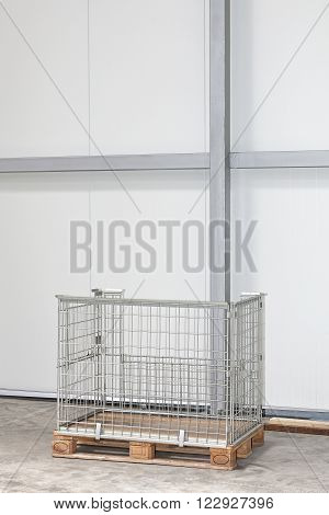 Wire Mesh Pallet Box in Empty Warehouse