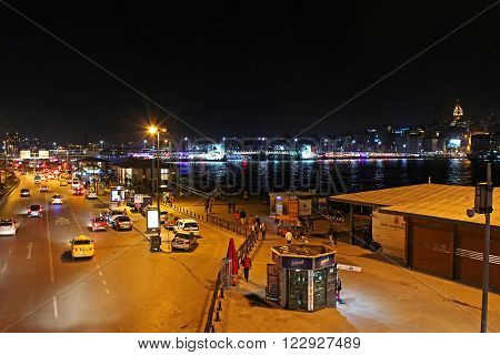 Istanbul, Turkey - March 31 2013: View over traffic next to Eminonu pier and Galata bridge at night in Istanbul, Turkey