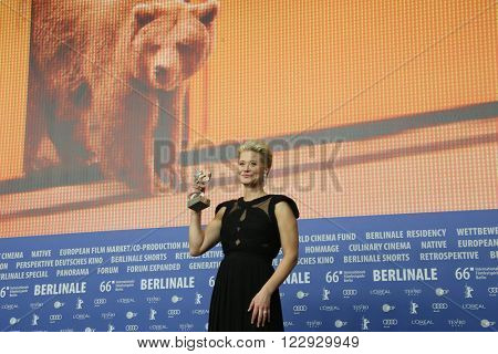 Trine Dyrholm poses with his award at the award winners press conference of the 66th Berlinale International Film Festival on February 20, 2016 in Berlin, Germany.