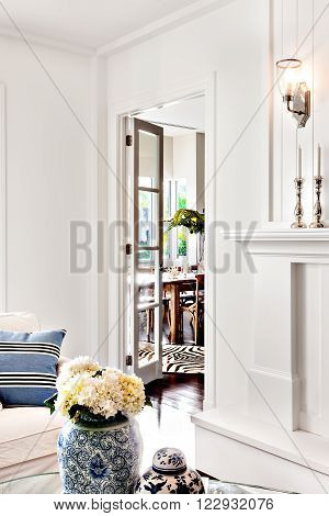 beautiful white flower in vase kept on table in room of luxury house