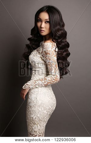 Sensual Asian Woman With Long Dark Hair In Elegant Lace Dress