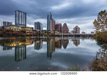 Austin downtown skyline by the river at night Texas.