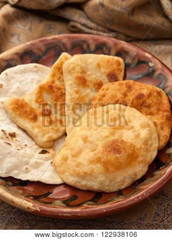 Food, Bakery. Some pastils on a plate, brown background