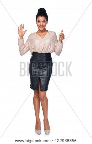 Hand counting - six fingers. Happy mixed race african american - caucasian woman showing six fingers standng in full length over white background