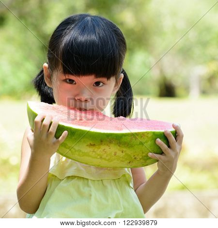 Little Child Eating Watermelon