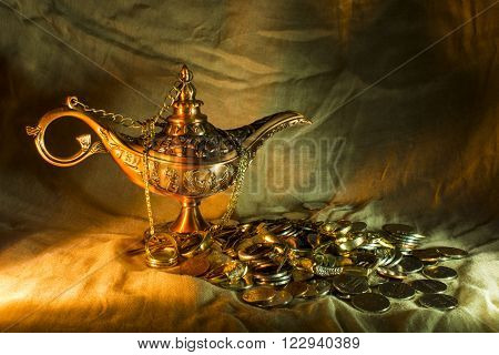Aladdin's lamp with gold jewels and coins