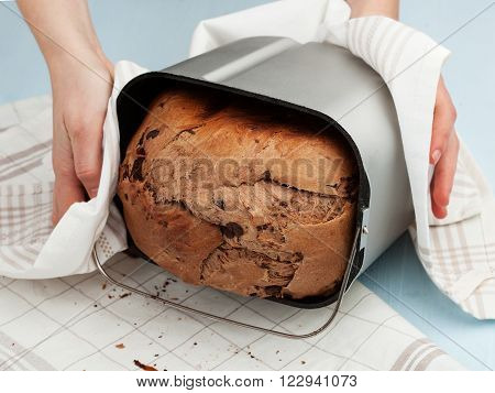 Woman's Hands Taking Off Bread From The Breadmaker